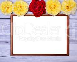 Empty wooden frame on a white wooden background, at the top of t