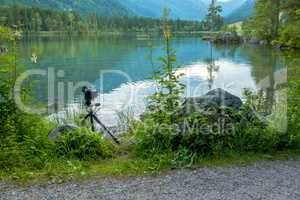 Mountain Forest Lake and Camera on a Tripod