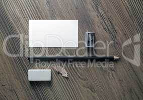 Business card, pencil, eraser, sharpener