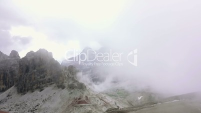 Quick Fog in the Rocks of the Dolomites. Fast Motion