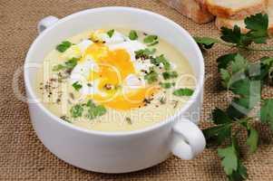 potato cream soup with poached eggs