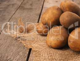 Rich harvest, organic potatoes on a rustic table