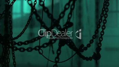 A lot of chins in the location. Room full of chains. Chains in dark space