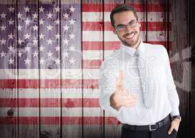 Smiling businessman offering his hand for independence day