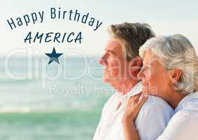 Blue fourth of July graphic against elderly couple looking out to sea