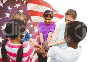 Happy children putting their hands together for independence day against 3d american flag