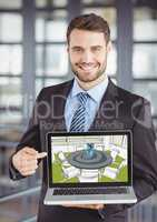 Young businessman smiling and sawing the design of the new  meeting room on the computer (green, gre