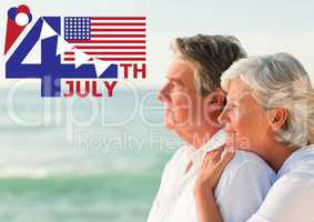 Fourth of July graphic with flags and ice cream against elderly couple looking out to sea