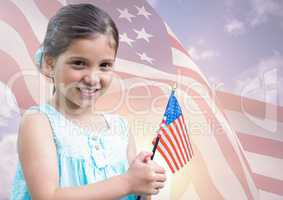 Smiling girl holding an american flag for independence day