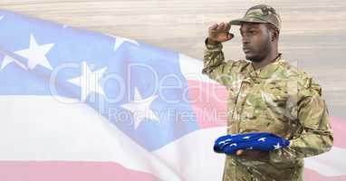 Side view of soldier holding an american flag in front of american background
