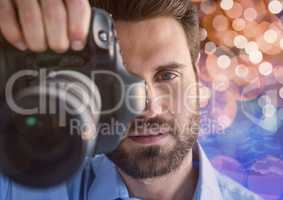 3d photographer foreground taking a photo with reflex. Blurred  brown and blue lights background and