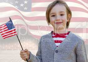 Smiling boy holding an american flag for independence day