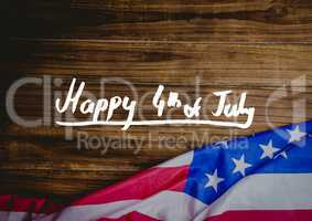 White fourth of July graphic against wood table and american flag