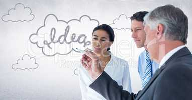Innovative business team looking at 3D idea graphic against white wall