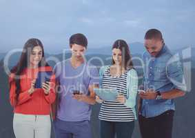 Friends using digital tablets and mobile phone in darkness atmosphere