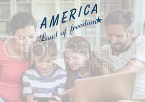 Happy american family looking at the digital tablet for the 4th of July