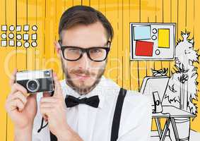 Millennial man with camera against yellow hand drawn office