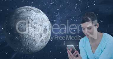 Smiling woman texting against universe background