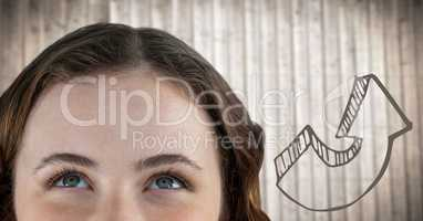 Top of woman's head next to 3D brown arrow against blurry wood panel