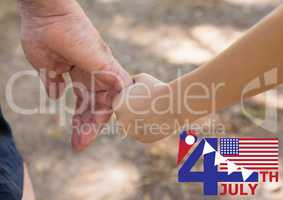 Fourth of July graphic with flags and ice cream against close up of father and son holding hands