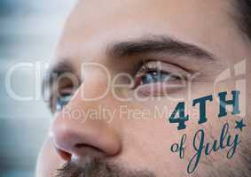 Close up of man's eyes with blue fourth of July graphic against blurry blue wood panel