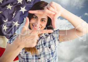 Smiling woman making a square with her hands for independence day