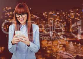 Woman Texting in rouge red night city