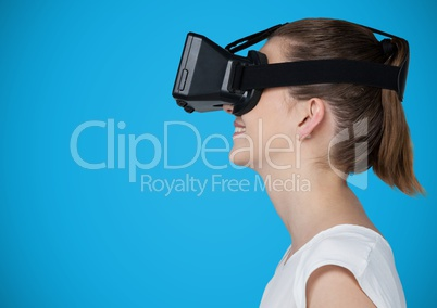 Woman in virtual reality headset against blue background