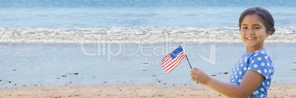 Girl with american flag on beach