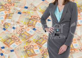 Business woman mid section hand on hip against money backdrop
