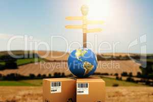 Composite image of courier with globe by road sign
