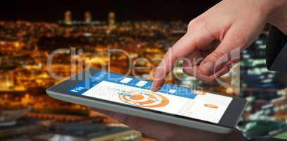 Composite 3d image of businesswoman hand using digital tablet