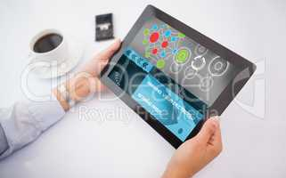 Composite 3d image of man using tablet pc
