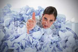 Composite image of conceptual image of woman in heap of crumple paper asking for help