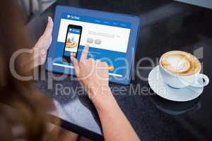 Woman having coffee and using her 3d tablet
