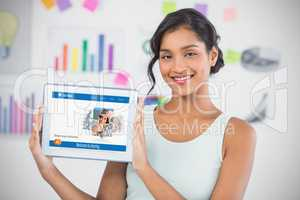 Happy businesswoman showing digital 3d tablet in creative office
