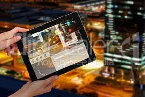 Composite 3d image of hands holding digital tablet against white background