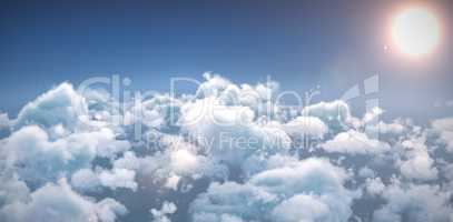 Idyllic view of bright sun over cloudscape during sunny day