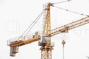 Cab lifting crane in the construction site.
