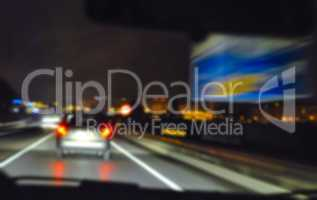 Blurred night traffic scene on the highway