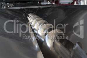 Wine process with grape harvest at working with destemmer machine photo