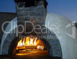 Outdoor stove for baking bread .