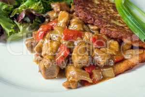 Hungarian goulash with potato pancakes