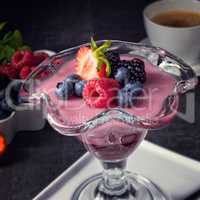 delicious pudding with wild berry