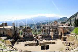 the Ancient Theatre of Taormina with Etna Mountain in background