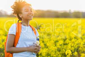 Mixed Race African American Girl Teenager In Yellow Flowers at S