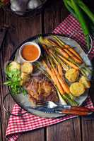 Grilled steak with vegetables and fried potatoes