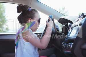 Girl pretending to drive a car