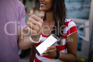 Couple paying bill through smartwatch
