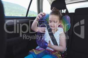 Girl playing with spiral accessories